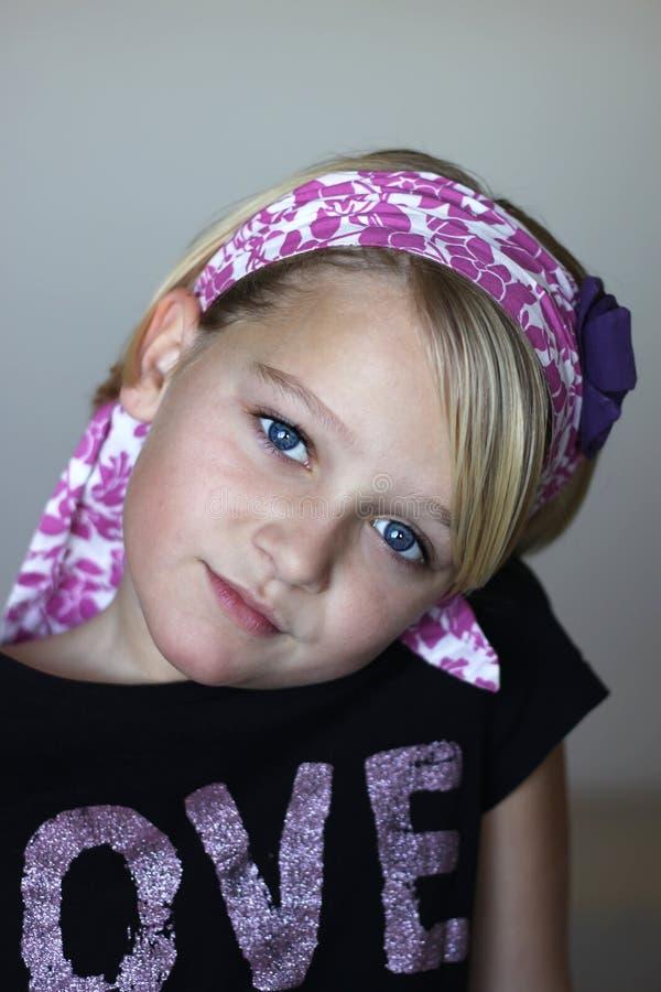 Retrato de uma menina bonita com lenço foto de stock royalty free