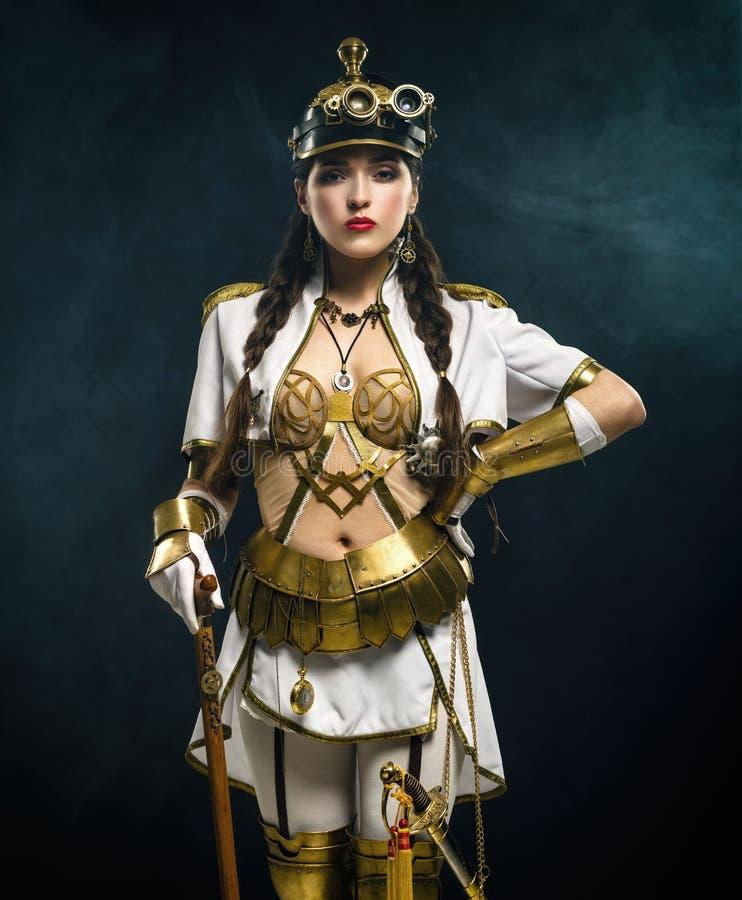 Retrato de uma menina bonita do steampunk com vara de passeio e sa imagens de stock