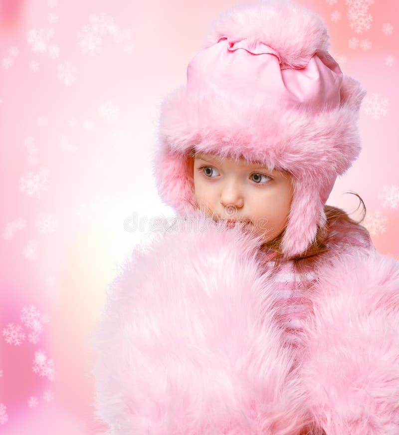 Retrato de uma menina bonita em um fundo abstrato fotos de stock
