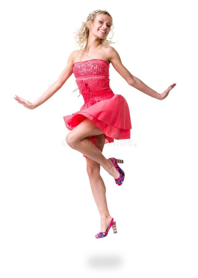 Retrato de uma menina bonita no vestido que salta, isolado no fundo branco fotos de stock