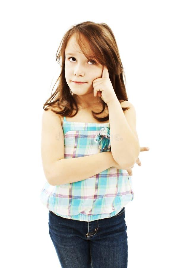 Retrato de uma menina bonita pequena pensativa foto de stock