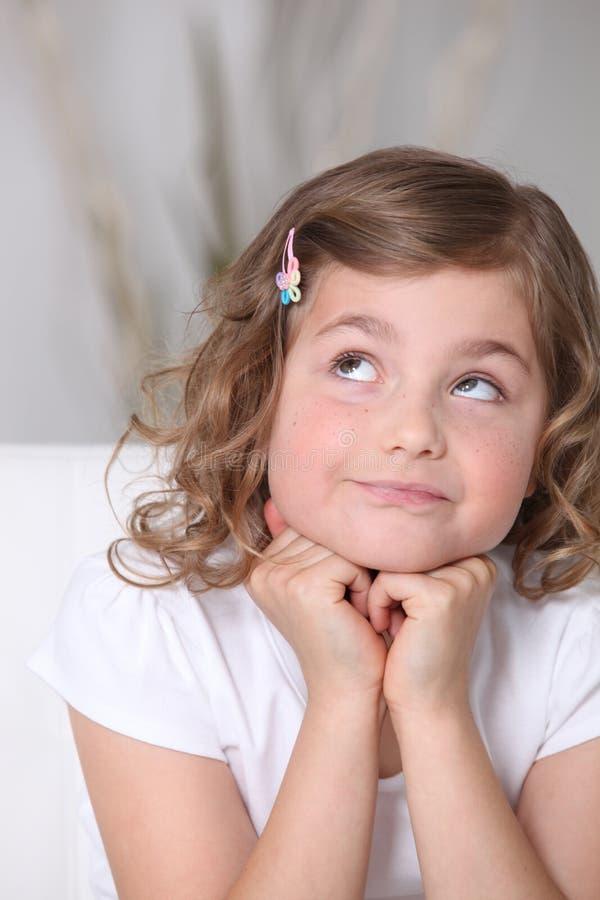 Retrato de uma menina pensativa fotografia de stock royalty free
