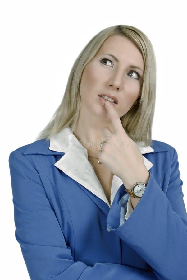 Retrato de uma mulher de negócio atrativa de dúvida fotografia de stock