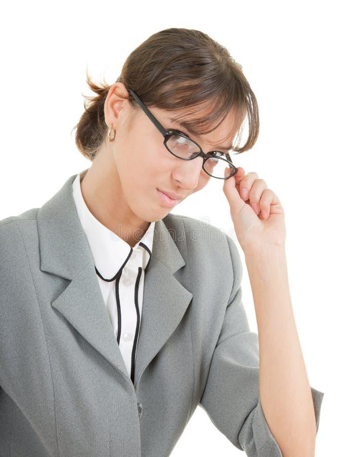 Retrato de uma mulher de negócio nos vidros foto de stock