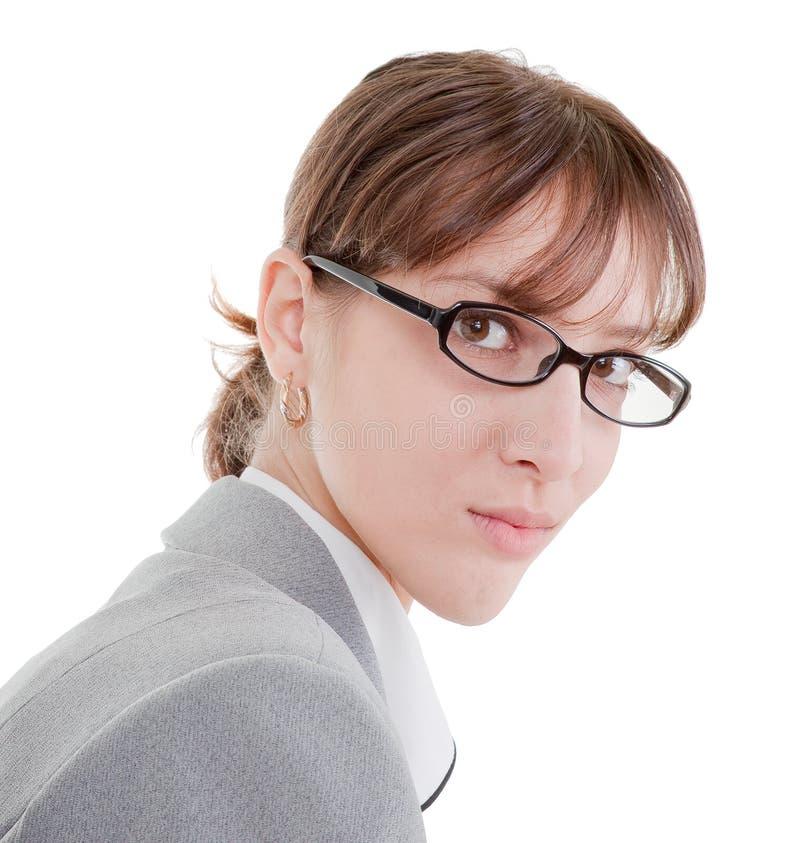 Retrato de uma mulher de negócio nos vidros fotografia de stock royalty free