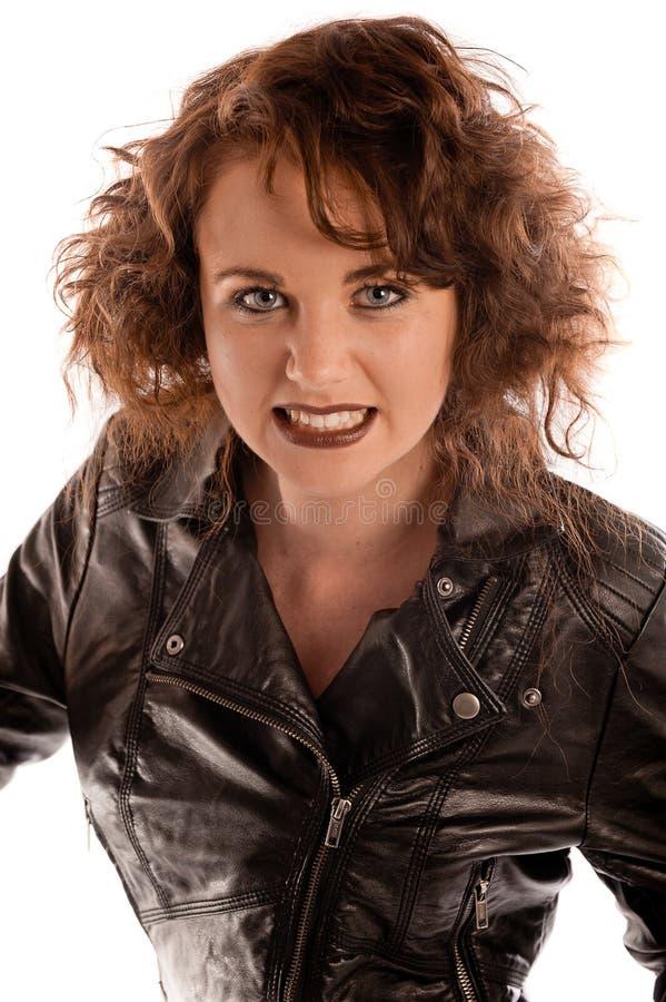 Retrato de uma mulher gótico bonita no casaco de cabedal preto fotografia de stock royalty free
