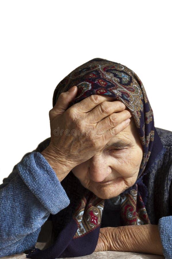 Retrato de uma mulher idosa triste fotografia de stock