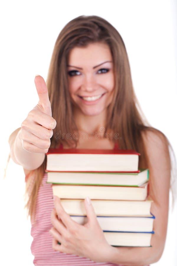 Retrato de uma mulher nova com os livros isolados fotografia de stock
