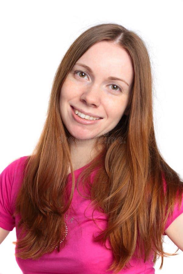 Retrato de uma mulher nova com um sorriso bonito imagens de stock royalty free