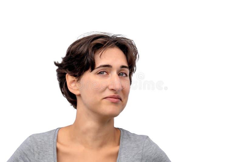 Retrato de uma mulher real nova, estudante fêmea com um olhar cético fotos de stock