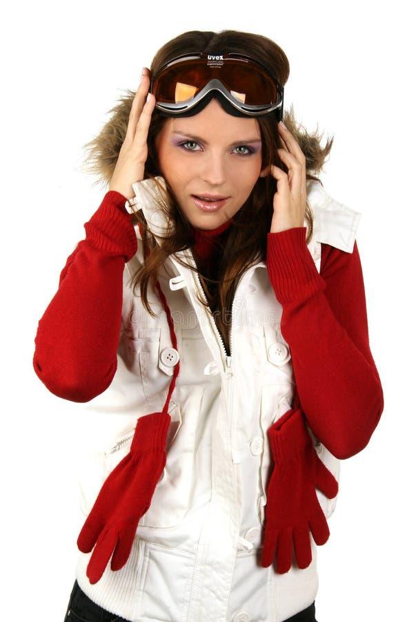Retrato de uma snowboarding feliz da rapariga foto de stock