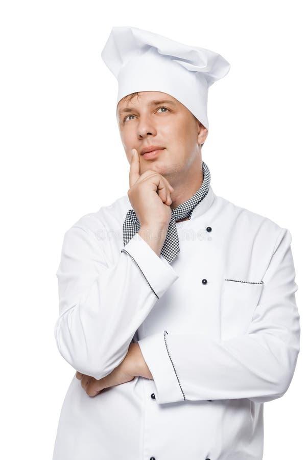 retrato de un cocinero hermoso pensativo en el traje de trabajo imágenes de archivo libres de regalías