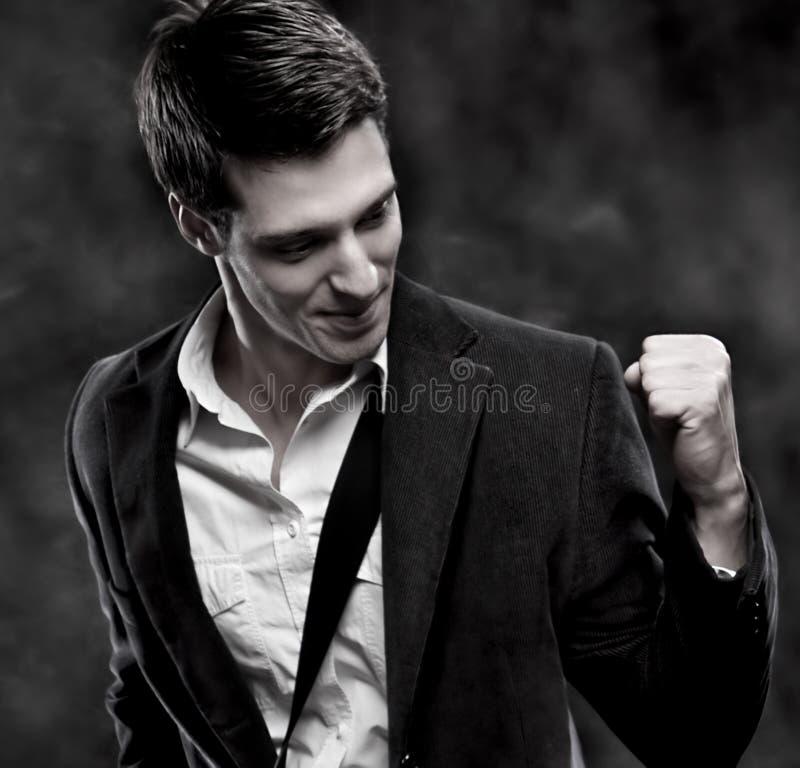 Retrato de un hombre de negocios acertado con el bolso imagen de archivo libre de regalías