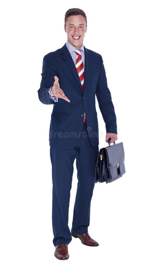 Retrato de un hombre de negocios joven con una cartera fotografía de archivo
