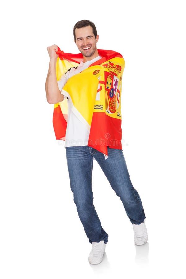 Retrato de un hombre feliz que sostiene un indicador español fotos de archivo