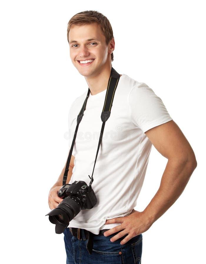 Retrato de un hombre joven hermoso con una cámara fotos de archivo libres de regalías