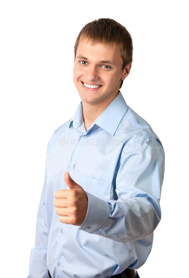 Retrato de un hombre joven hermoso, pulgar para arriba foto de archivo libre de regalías