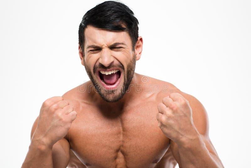 Retrato de un hombre muscular atheltic que grita fotos de archivo