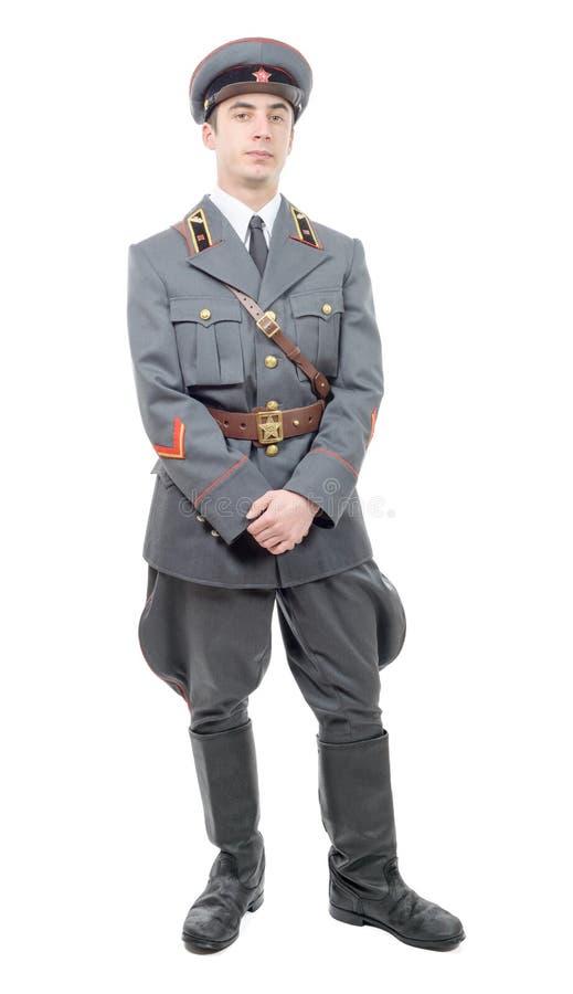 Retrato de un oficial joven del ejército soviético, aislado en pizca fotografía de archivo