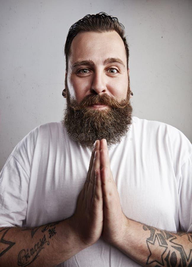 Retrato de un petición barbudo del hombre fotos de archivo