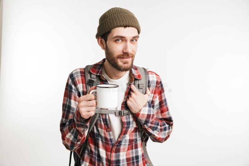 Retrato de un turista barbudo feliz del hombre en camisa de tela escocesa fotografía de archivo