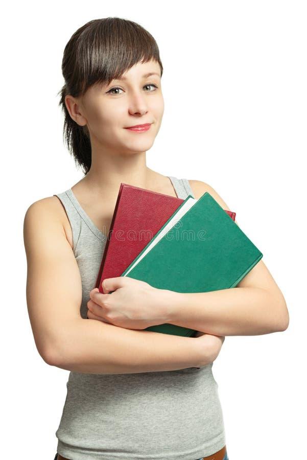 Retrato de una muchacha sonriente con los libros foto de archivo