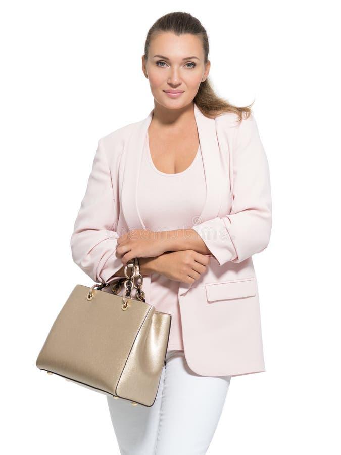 Retrato de una mujer adulta bonita con el bolso imagen de archivo