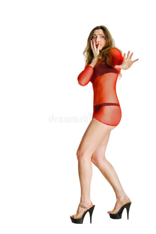 Retrato de una mujer asustada en el rojo foto de archivo libre de regalías