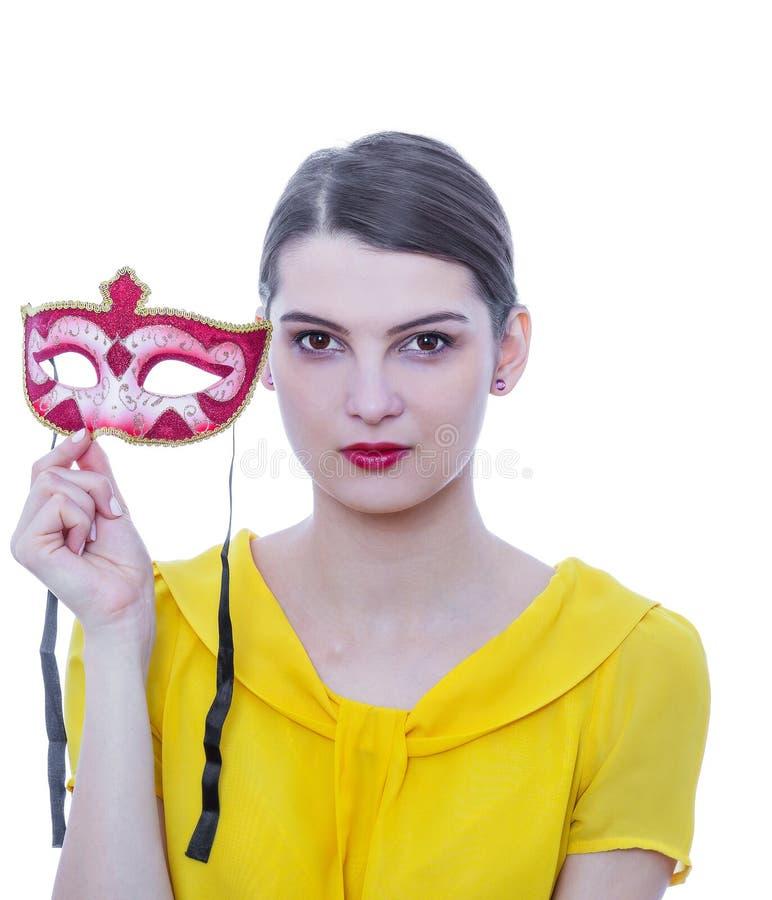 Retrato de una mujer joven con una máscara fotografía de archivo libre de regalías