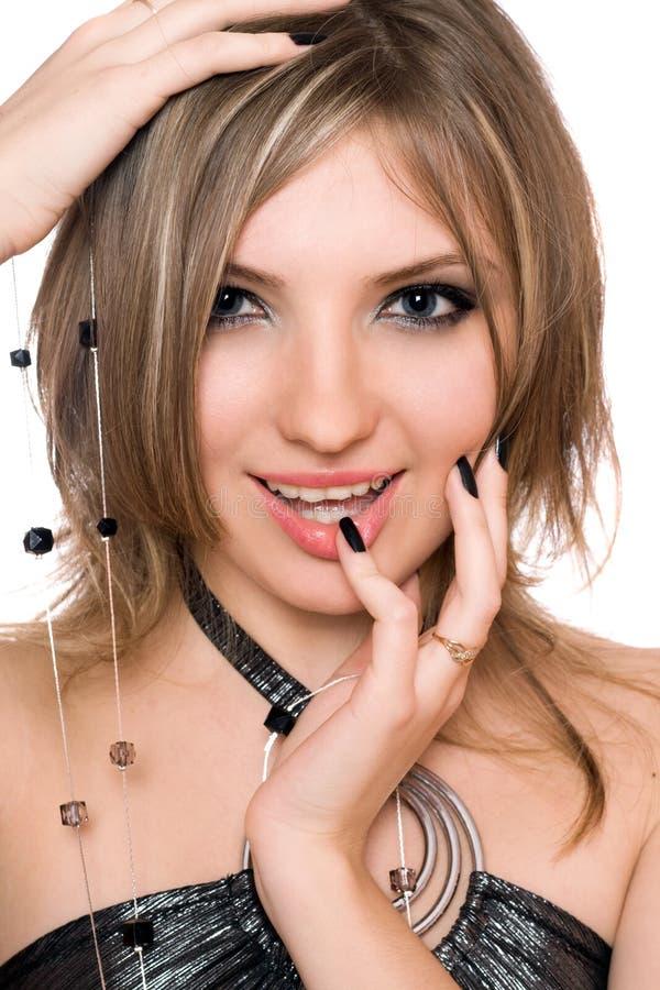Retrato de una mujer joven hermosa sonriente Aislado imagenes de archivo