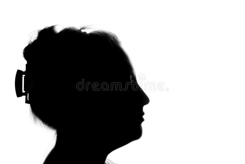 Retrato de una mujer joven, vista lateral imagen de archivo