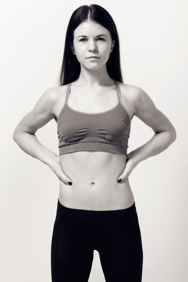 Retrato de una mujer morena flaca joven imagen de archivo