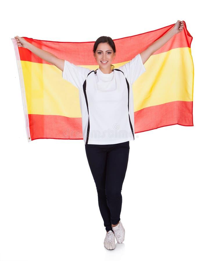 Retrato de una mujer que sostiene el indicador español foto de archivo
