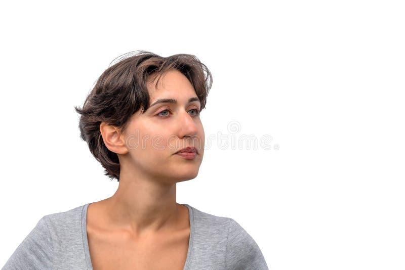 Retrato de una mujer real joven, estudiante útil serio fotografía de archivo