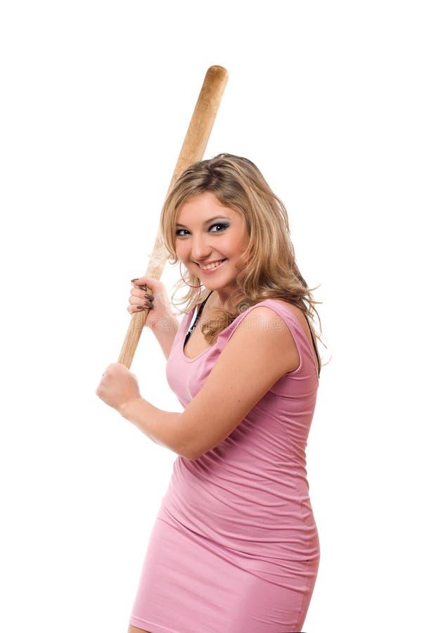 Retrato del blonde joven alegre con un palo foto de archivo
