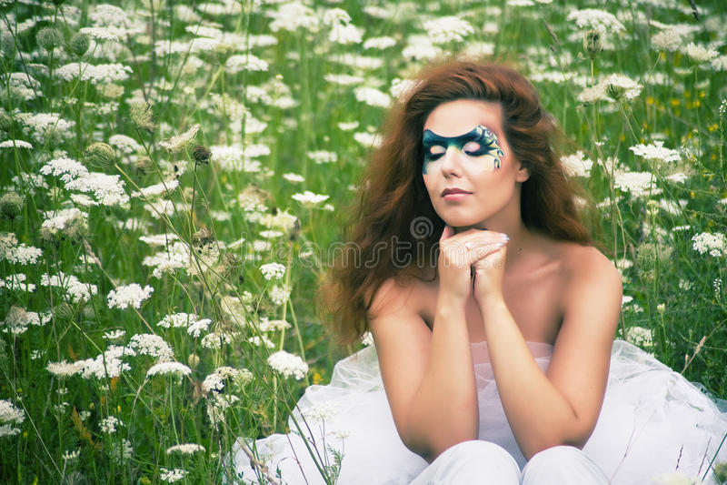 Retrato Del Cara-arte De Una Mujer Hermosa Foto de archivo