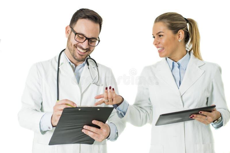 Retrato del doctor de sexo masculino y de sexo femenino fotos de archivo libres de regalías