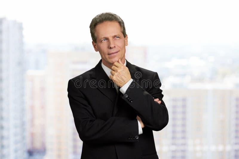 Retrato del empresario de sexo masculino pensativo imágenes de archivo libres de regalías