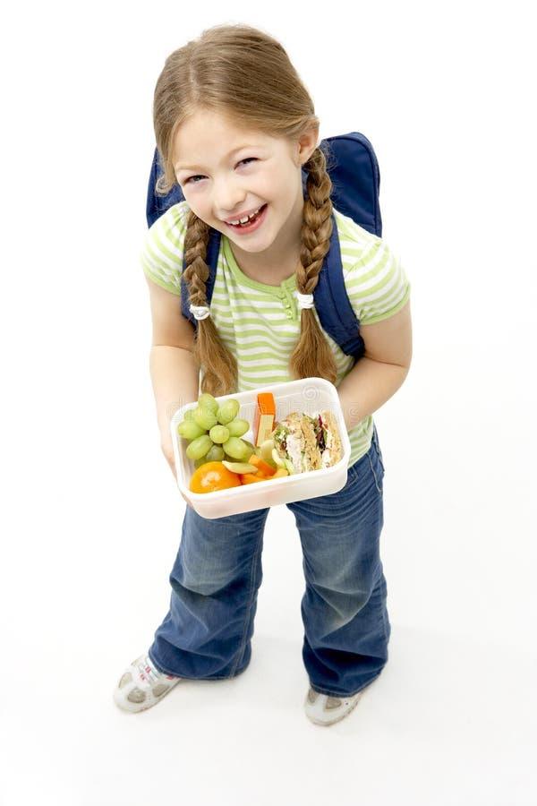 Retrato del estudio de la caja del almuerzo sonriente de la explotación agrícola de la muchacha imagenes de archivo