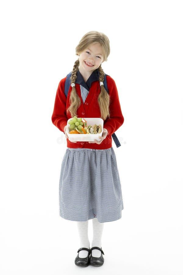 Retrato del estudio de la caja del almuerzo sonriente de la explotación agrícola de la muchacha imágenes de archivo libres de regalías