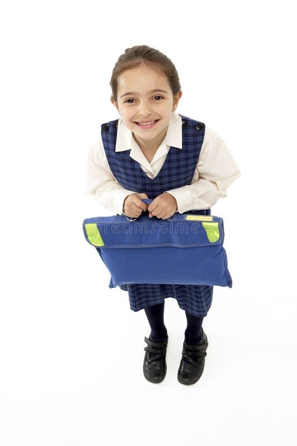 Retrato del estudio del bolso de escuela sonriente de la explotación agrícola de la muchacha fotos de archivo libres de regalías