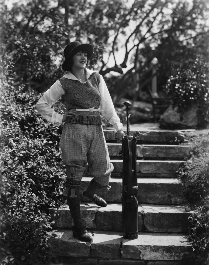 Retrato del golfista de sexo femenino sonriente (todas las personas representadas no son vivas más largo y ningún estado existe G fotos de archivo