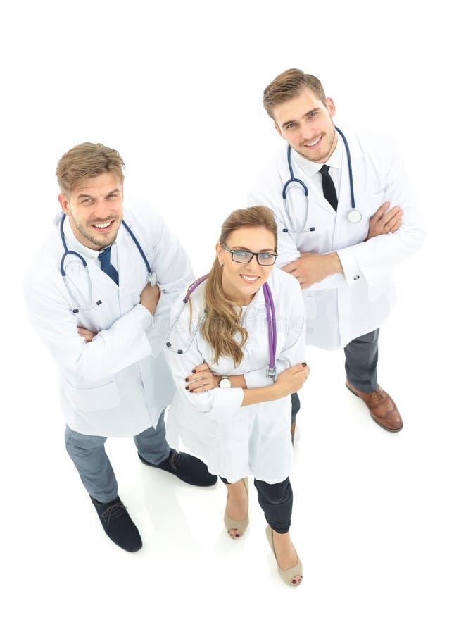 Retrato del grupo de colegas sonrientes del hospital que colocan el togeth fotografía de archivo libre de regalías