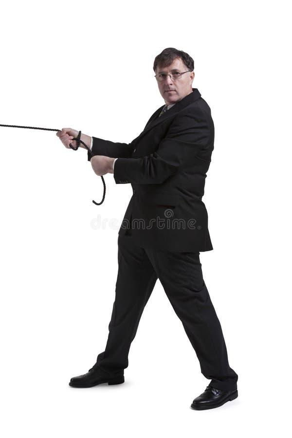 Retrato del hombre de negocios maduro Pulling Rope fotos de archivo libres de regalías