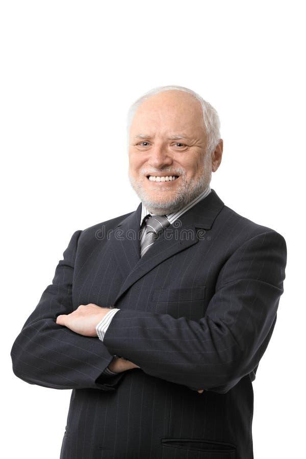 Retrato del hombre de negocios mayor feliz foto de archivo