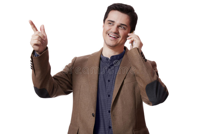 Retrato del hombre de negocios que usa el teléfono móvil en el fondo blanco fotografía de archivo