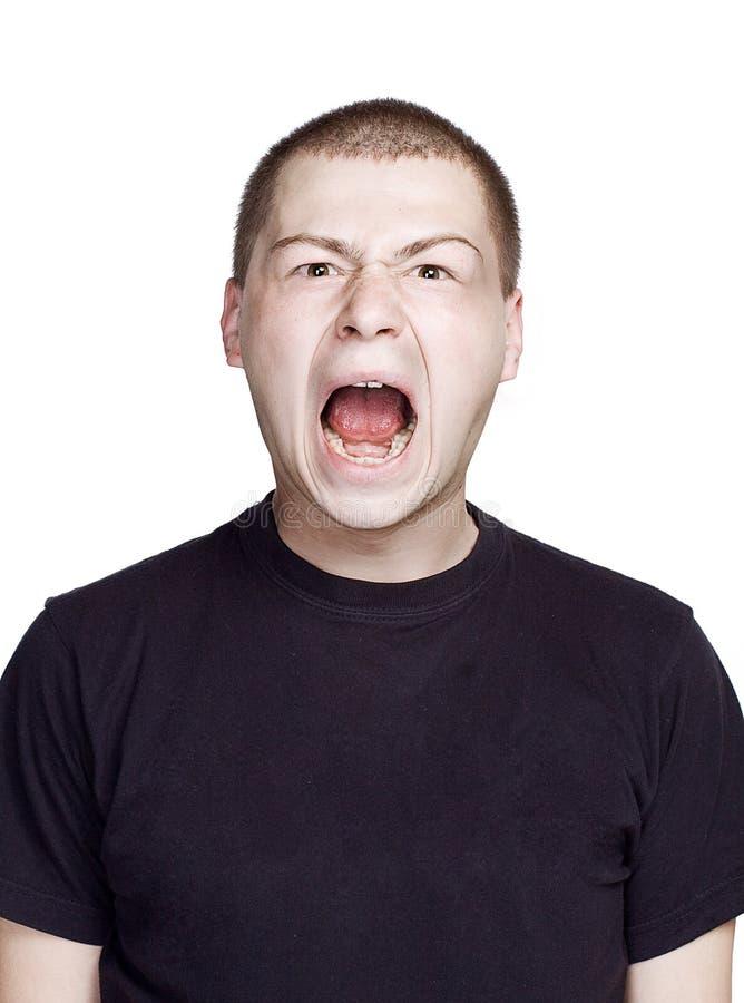 Retrato del hombre joven Expresi?n facial Cara del grito imágenes de archivo libres de regalías