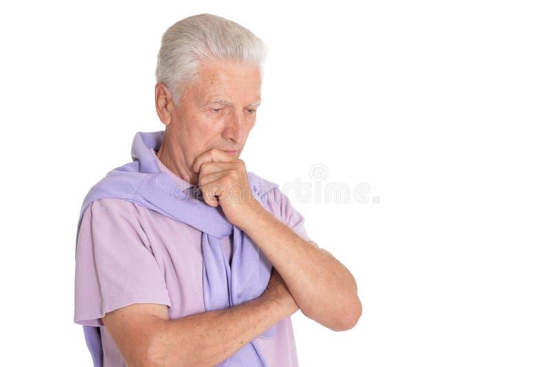 Retrato del hombre mayor en el fondo blanco imagenes de archivo
