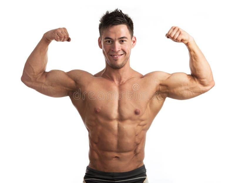 Retrato del hombre muscular que dobla su bíceps fotografía de archivo libre de regalías