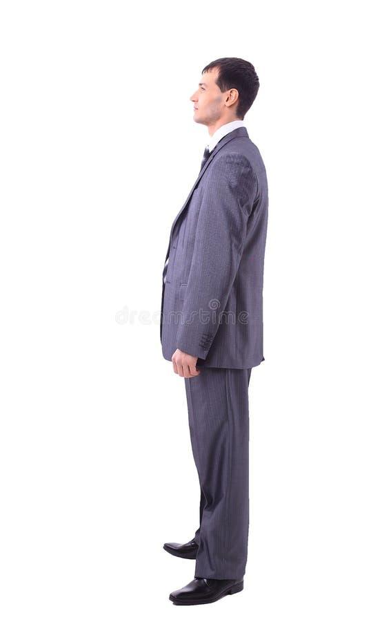 Retrato del hombre que mira lejos aislado en el fondo blanco imagenes de archivo